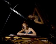 Haley with a grand piano at CSI.