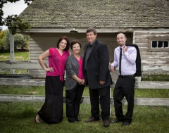 A family picture outdoors at Addison Photography.