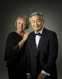 A portrait of Sue Miller and Carson Wong.