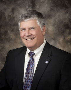 Studio portait of Twin Falls County Commissioner Terry Kramer.