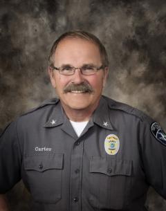 Studio portait of Twin Falls County Sheriff Tom Carter.