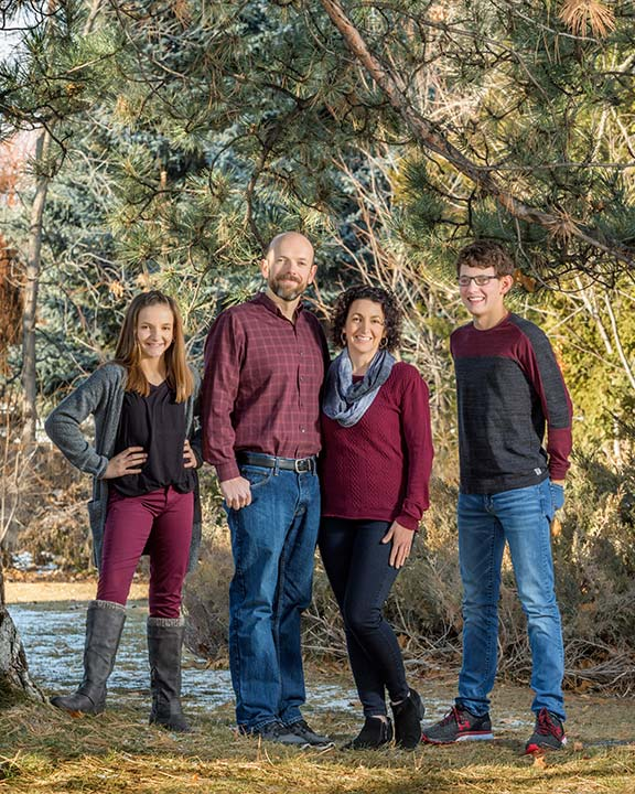 The Celeya family posing together on the studio grounds for a family picture.