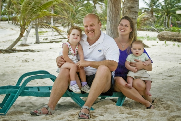 A family picture on the beach in Mexico.